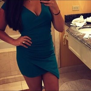 Windsor emerald green slant hem dress